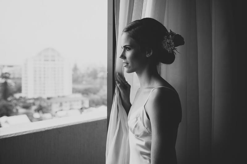 CENTRAL DOCKSIDE APARTMENTS WEDDING BRIDE LOOKING AT RAIN