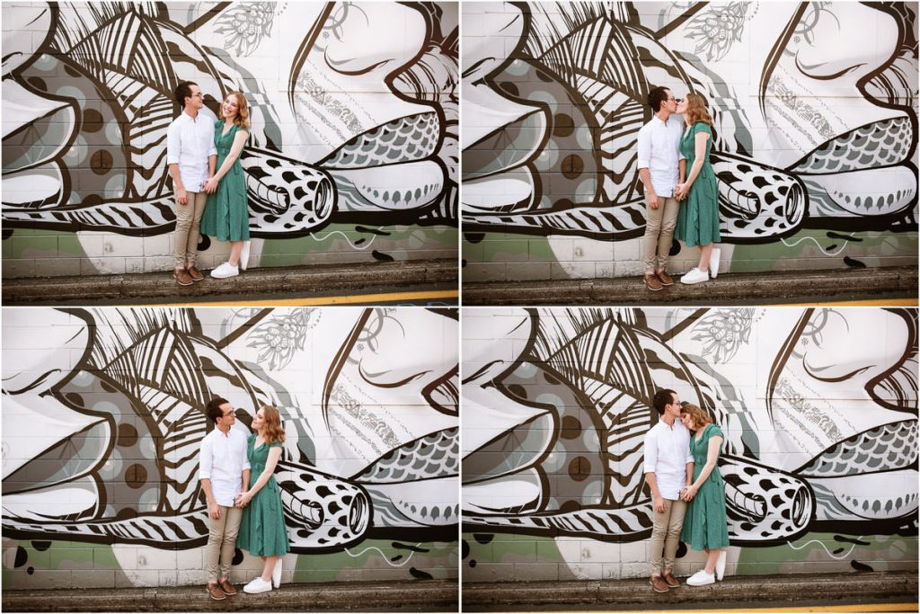 Engaged couple Brendan and Sarah photographed in front of a graffiti wall in Brisbane Fish Lane