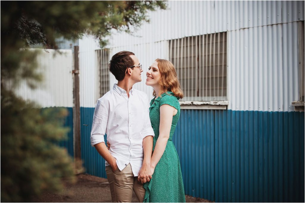 Young couple embracing in West end on engagement session