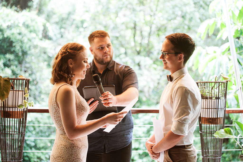 Bride Sarah presenting her vows to Groom Brendan during their Cairns Treehouse Wedding