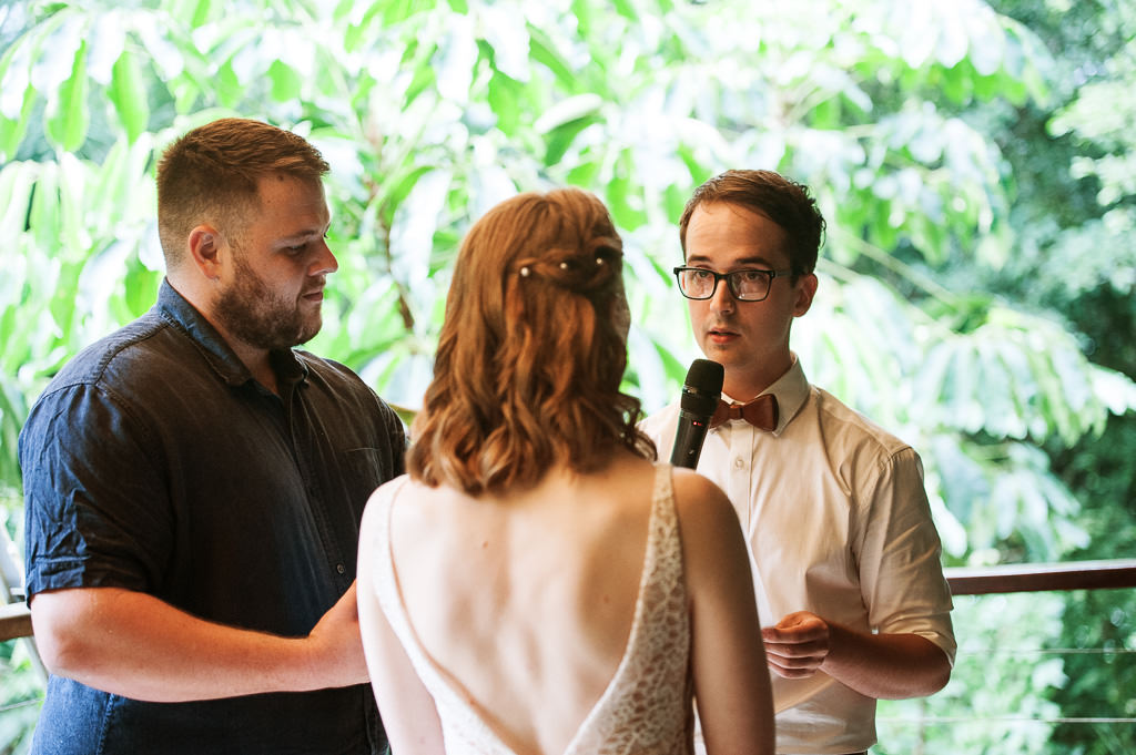 Groom Brendan presenting his vows to Bride Sarah during their Cairns Treehouse Wedding