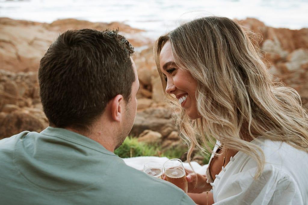 Couple snuggling with Champaigne on the Sunshine Coast