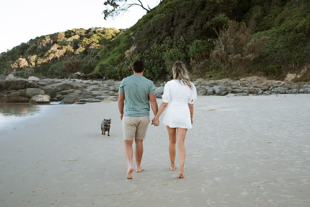 Couple walking along First Bay Coolum