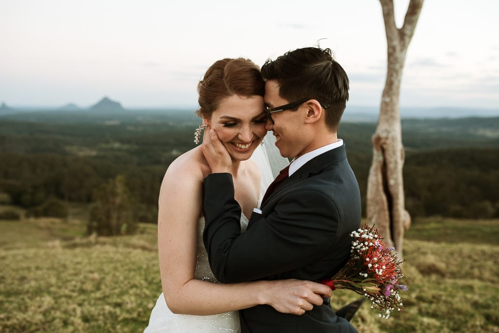 Terri Hanlon Photography - couple embraced and smiling at One Tree Hill Maleny
