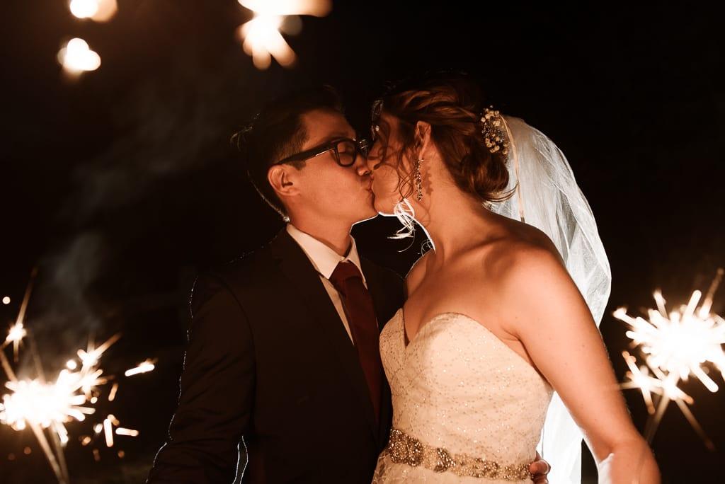 Terri Hanlon Photography - Couple with sparklers kissing