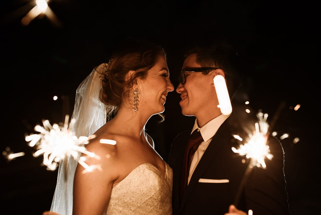 Terri Hanlon Photography - Couple with sparklers celebrating their elopement