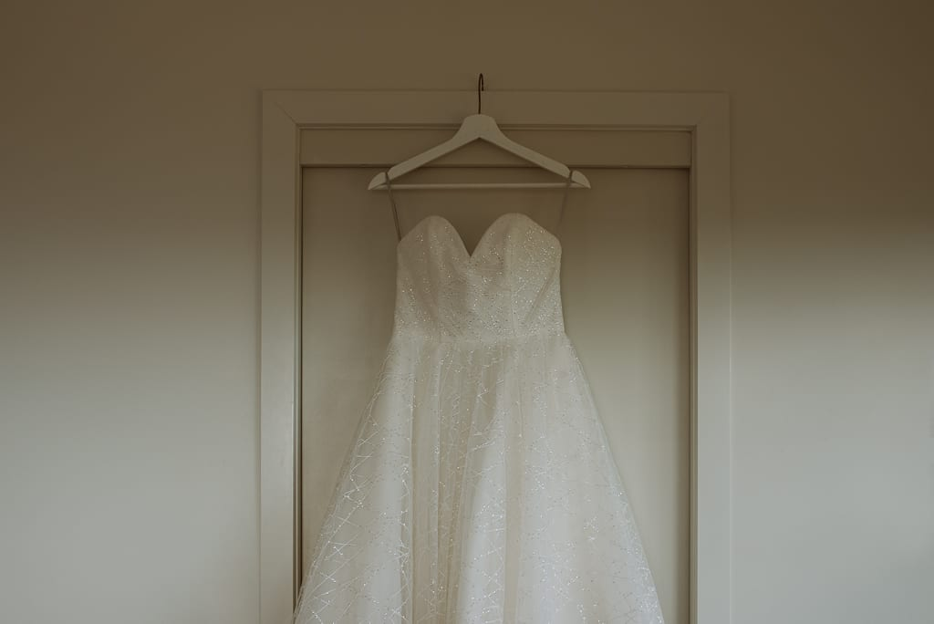 Terri Hanlon Photography - Bridal gown hung up in accomodation The Space BetweenMaleny