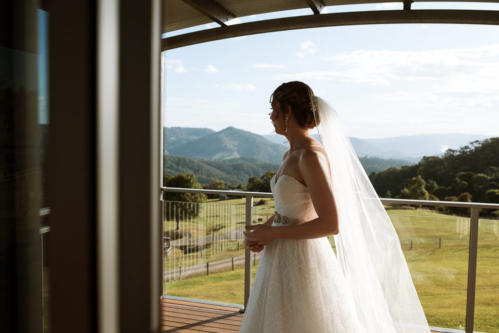 Terri Hanlon Photography - bride looking at view from the deck of The Space Between accomodation Maleny
