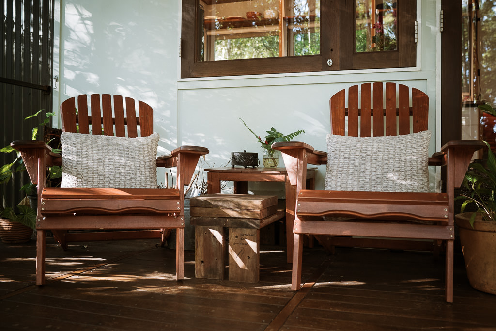 Muskoka chairs on the deck of the Maleny Tiny House