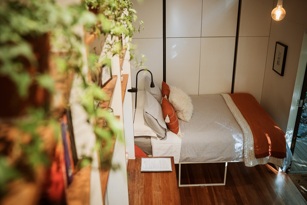 The bedroom view from the loft inside the Maleny Tiny House