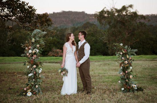 roscrea homestead bride and groom portraits backdrop of mountains